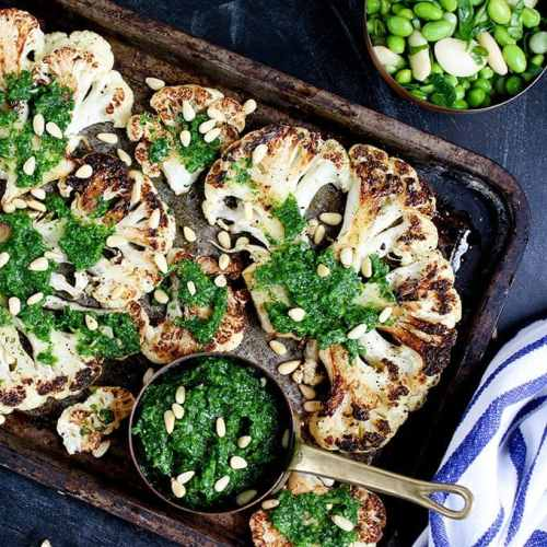 Cauliflower steak with spicy salsa verde. Cauliflower fried until golden, then poached in stock - a great meatless Monday meal!