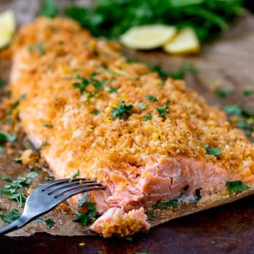 This Garlic Bread Crusted Salmon makes an easy and tasty centerpiece for your family table! The crispy coating ensures the salmon is beautifully moist!