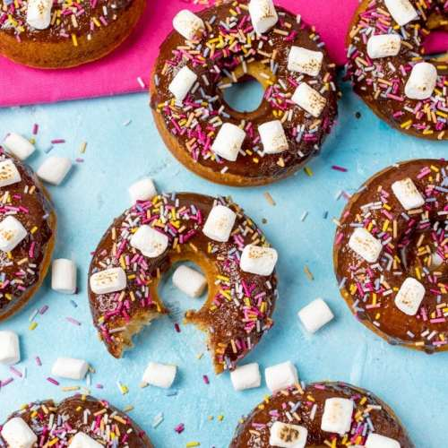 Chocolate Baked S'mores Doughnuts - quick and easy doughnuts with chocolate ganache, marshmallows and lots of sprinkles! Great for a bakesale!
