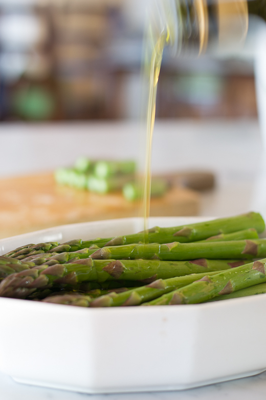 drizzle oil on asparagus