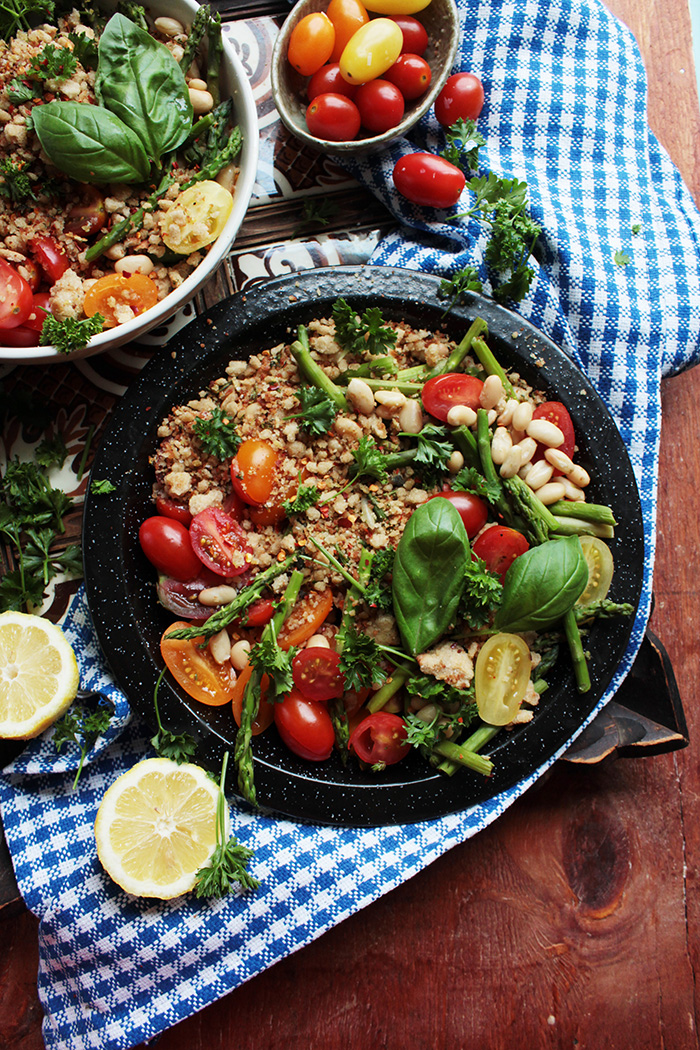 This bowl is piled high with summer tomatoes and thin, fresh asparagus. Hearty white beans turn it into a meal, and herbed breadcrumbs make it extra special. This perfect summer meal is cheap, quick, and healthy.