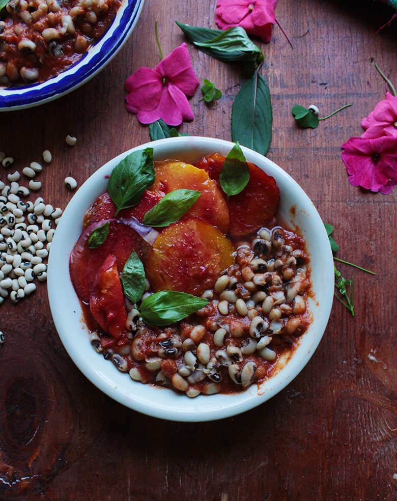 This simple meal can be ready in about 30 minutes. A lovingly spiced homemade tomato sauce gives life to black eyed peas, and late season peaches bloom in sweetness under a broiler. This is a budget friendly meal, perfect for weeknights.