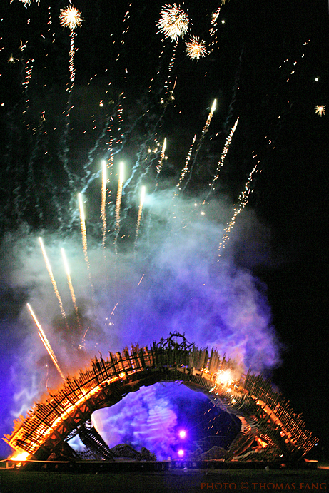 Fireworks burst above the 2011 effigy, Burning Bridges, setting it aflame. Pyropolis, Texas. Photo by Thomas Fang, used with permission. Click for full-sized version.