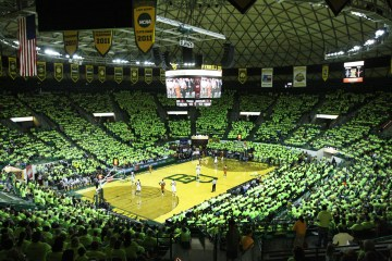 """Baylor fans throughout the Ferrell Center put on bright neon shirts in a motion to have the Texas players become """"Blinded by Green & Gold"""" during the game Saturday afternoon, Jan. 28, 2012.  The Longhorns suffered a 76-71 defeat to the Bears.  Matt Hellman 