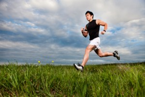 Asian Fitness Man Running Through Field