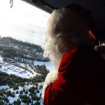 Coast Guard Santa waves to the community of Danger Bay, AK, before  landing to bring gifts to the children on Dec. 13, 2016.  U.S. Coast Guard  photo by Petty Officer 3rd Class Lauren Steenson