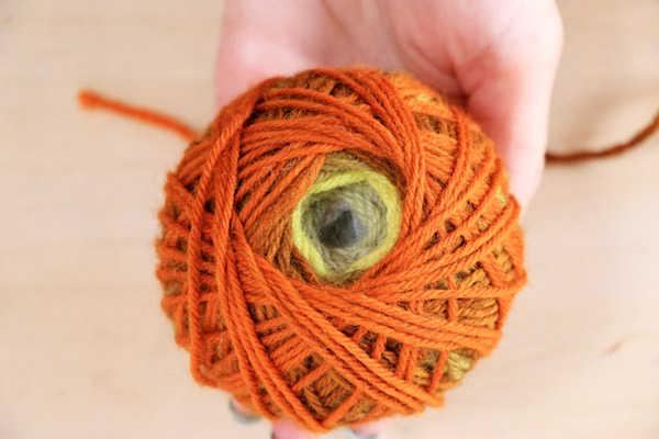 Make a magic yarn ball with needle felting