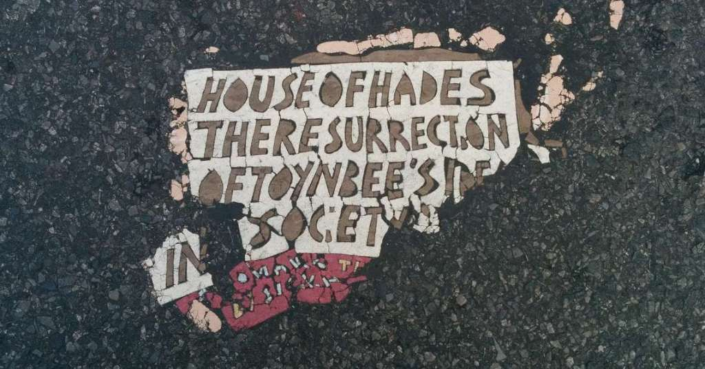 House_of_Hades_Toynbee_tile_at_20th_and_6th_Ave_in_New_York_City_November_2013