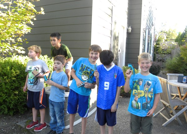 """Each boy had a pick axe. The game consisted of each one taking turns to """"mine"""" in the backyard and find 1 treasure chest."""