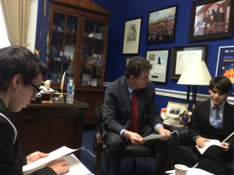 Congressman Mike Fitzpatrick giving the boys an advanced copy of his speech, in Braille