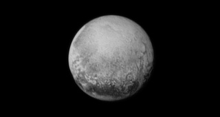 Pluto, from a distance of just over 1.2 million miles. That ring of mountains could mean that Pluto is the result of two smaller bodies smacking into each other. That looks like a collision seem to us.