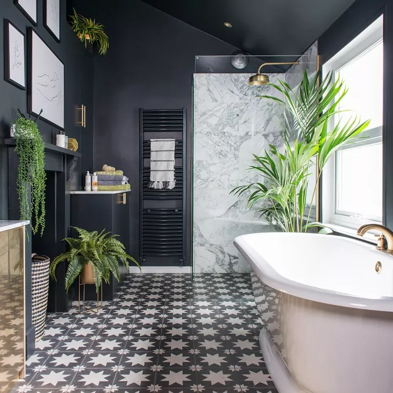 Black Bathroom Makeover With Patterned Floor Tiles Plants And Roll Top Bath