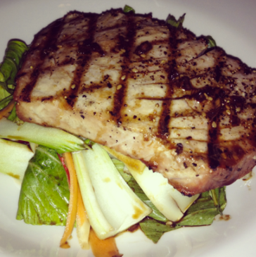 Char-grilled fresh Tuna steak served on pak choi and sugar snap pea salad with toasted sesame seeds, lime and soya dressing