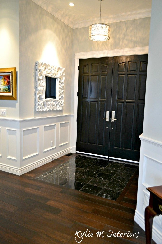 Double Crown Molding Entryway With Dark Wood Flooring, Black Marble Tile And