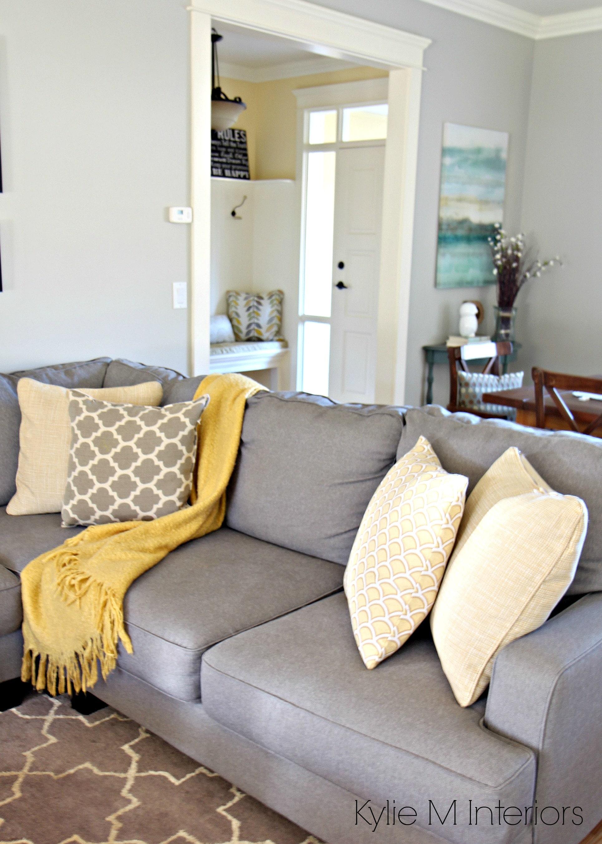 Yellow And Gray Living Room How To Make A Gray Paint Colour Feel Warm Shown In Living