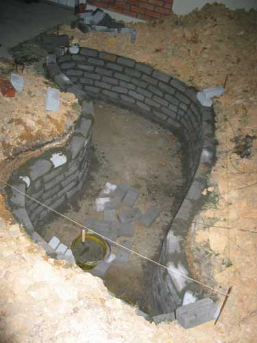 constructing the brick wall for koi pond wall