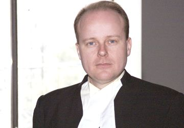Maître John F. Johnson.
