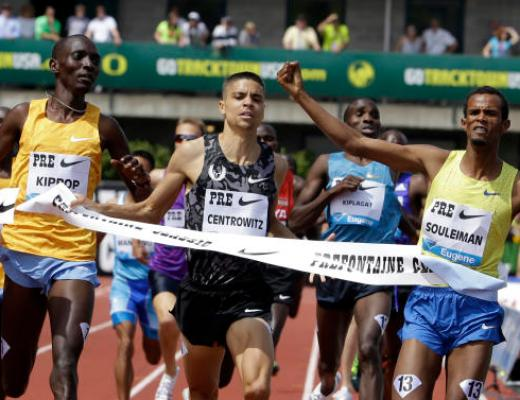 Ayanleh Souleiman, right, from Djibouti, wins the mile race ahead of Asbel Kiprop, left, from Kenya, and Matthew Centrowitz during the Prefontaine Classic track and field meet in Eugene, Ore., Saturday, May 30, 2015. Kiprop took third and Centrowitz finished second.  (AP Photo/Don Ryan)
