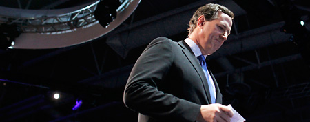 Republican presidential candidate, former Pennsylvania Sen. Rick Santorum, leaves the stage after speaking before the American Israel Public Affairs Committee (AIPAC), in Washington, Tuesday, March 6, 2012. (AP Photo/Charles Dharapak)