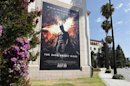 "A poster for the Warner Bros. film ""The Dark Knight Rises"" is displayed in Burbank"