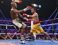 Manny Pacquiao lands a punch on Floyd Mayweather during their welterweight fight Saturday. (Reuters)