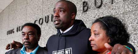 Brian Banks, center, reacts with his mother, Leomia Myers and father, Jonathan Banks, outside court after his rape conviction was dismissed Thursday May 24, 2012 in Long Beach, Calif. ( AP Photo/Nick Ut)