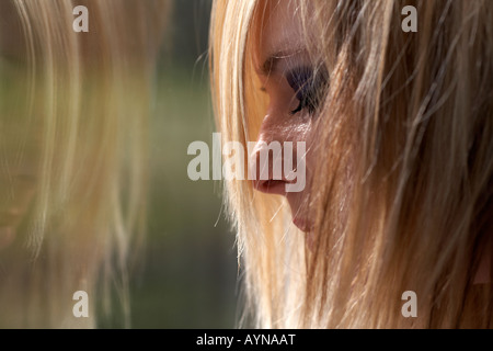 Young Woman Looking Sad And Dirty Tied To A Chair Stock