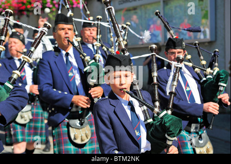 Scottish Marching Band With Bagpipes Procession To