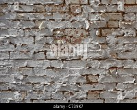 old paint peeling brick wall with spray painted question ...