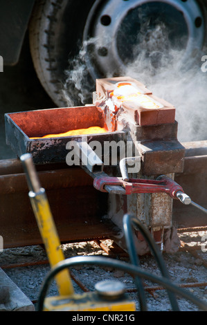 Thermite welding of tram tracks during Metrolink construction Stock - thermite welding