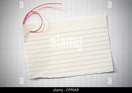 torn lined paper with red wire in shape of number six over data - horizontal writing paper