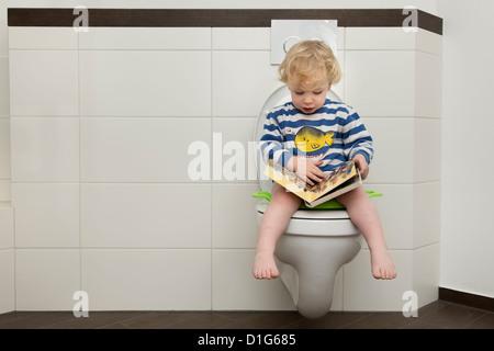 Toddler Reading On The Toilet Stock Photo 277038646 Alamy