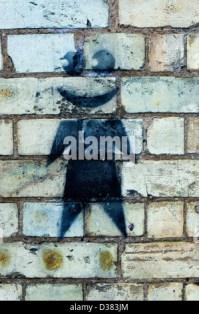 A graffiti spray painted brick wall using red black and ...