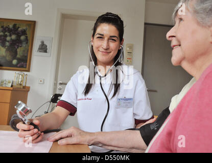 Hungarian trainee for geriatric nursing, Dora Fekete, checks the