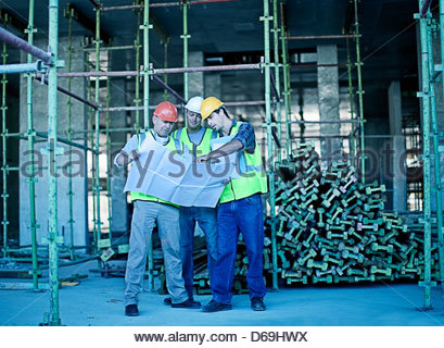 Construction workers reading blueprint Stock Photo 48585075 - Alamy - reading blueprints