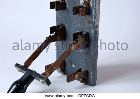 Closeup antique old electrical fuse box breaker switch brass Stock