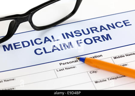Medical claim form and ballpoint pen Stock Photo, Royalty Free - medical claim form