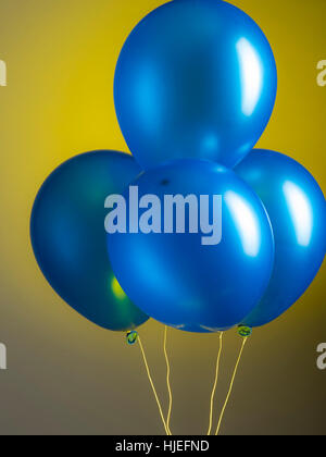 Blue party balloons on graduated background Stock Photo 131856059