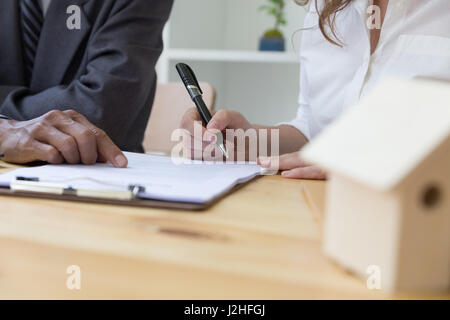 womanu0027s hand hold ballpoint pen writing on agreement paper sheet - writing contract agreements
