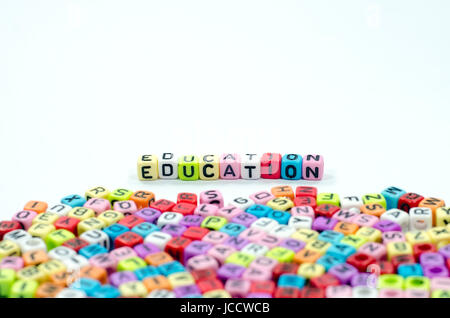 word education spell using colorful alphabets beads Stock Photo - word alphabets