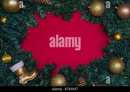 Background with Christmas theme, pine leaves on the edges of red - christmas theme background