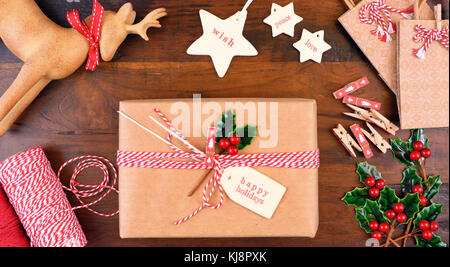Christmas gift wrapping overhead in rustic theme with brown Kraft
