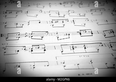 Musical staves with five horizontal lines and different notes Stock