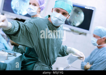 Surgical nurse at work during an operation Stock Photo 175575042