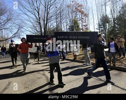Audubon, NJ, USA 24th Mar, 2018 Students carry cardboard coffins