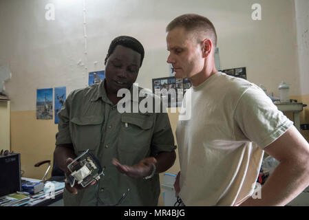 Onesime Kaoueye, chief biomedical technician, shows US Army