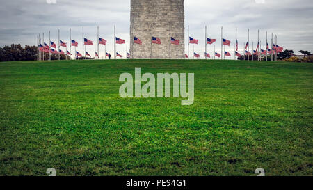 A circle of American flags at the base of the Washington Monument in