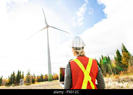 A Technician woman Engineer in Wind Turbine Power Generator Station