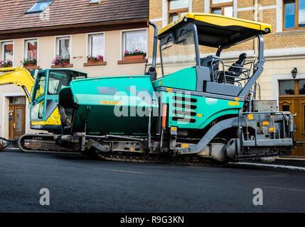 Asphalting works surfacing road machine Stock Photo 167127668 - Alamy