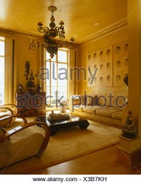 Large white sofas in yellow Spanish living room with ...